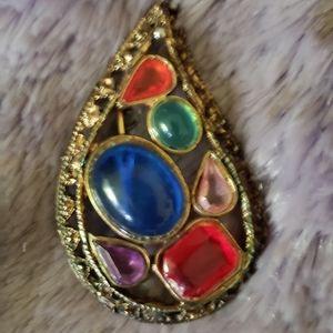 Gemstone pin in gold tone metal